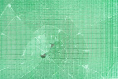 Σπασμένο διακοσμητικό και στιλπνό παράθυρο φραγμών γυαλιού ως σύσταση ή για το υπόβαθρο ανασκόπηση γεωμετρική Στοκ Φωτογραφία