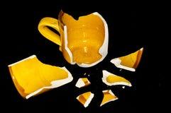 Σπασμένο πορτοκαλί φλυτζάνι Coffe Στοκ Εικόνες