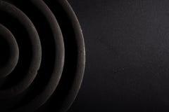 Σπείρες κουνουπιών σε ένα μαύρο υπόβαθρο Στοκ φωτογραφία με δικαίωμα ελεύθερης χρήσης