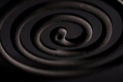 Σπείρες κουνουπιών σε ένα μαύρο υπόβαθρο Στοκ φωτογραφίες με δικαίωμα ελεύθερης χρήσης