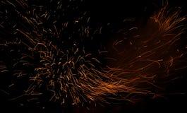 Σπινθήρας πυρκαγιάς φυσήματος κροτίδων Στοκ Φωτογραφίες