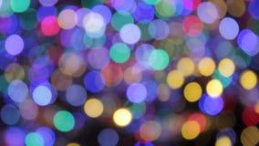 Σπινθηρίσματος bokeh υποβάθρου τα χρυσά de-στραμμένα περίληψη bokeh αφηρημένα Χριστουγέννων φω'τα σημείων θαμπάδων λαμπυρίσματος  απόθεμα βίντεο