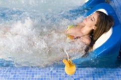 σπορείο που έχει juice orange spa τη γυναίκα Στοκ Εικόνες