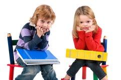 Σπουδαστές στις καρέκλες στοκ φωτογραφία