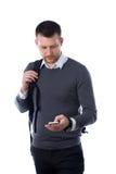 Σπουδαστής με το σακίδιο πλάτης που χρησιμοποιεί το smartphone Στοκ φωτογραφία με δικαίωμα ελεύθερης χρήσης