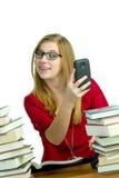 Σπουδαστής στο κινητό τηλέφωνο Στοκ εικόνα με δικαίωμα ελεύθερης χρήσης