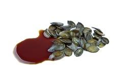 Σπόροι κολοκύθας με το πετρέλαιο σπόρου κολοκύθας Στοκ Εικόνα