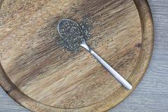 Σπόροι Chia σε ένα κουτάλι Στοκ Εικόνες