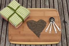 Σπόροι Chia στη μορφή της καρδιάς Στοκ Εικόνα