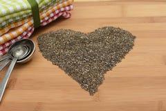 Σπόροι Chia στη μορφή της καρδιάς Στοκ Εικόνες