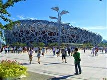 Στάδιο, πουλί & x27 του Πεκίνου εθνικό φωλιά και τουρισμός του s στην Κίνα στοκ εικόνα