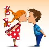 Στάση φιλήματος αγοριών και κοριτσιών Στοκ Φωτογραφία