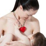 Στήθος μητέρων - που ταΐζει Στοκ Εικόνες