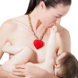 Στήθος μητέρων - που ταΐζει Στοκ Φωτογραφία