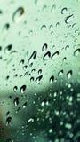 Σταγόνες βροχής στο γυαλί Στοκ Φωτογραφία