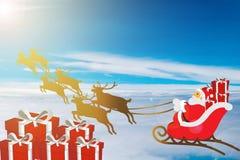 Σταυρός Santa με τον τάρανδο στον ουρανό Στοκ Εικόνες