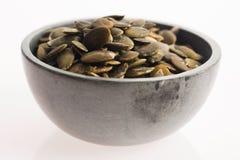 στενοί σπόροι κολοκύθας τροφίμων ανασκόπησης επάνω Στοκ Εικόνες