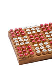 Στενός επάνω επιτραπέζιων παιχνιδιών Sudoku στο λευκό Στοκ Εικόνες