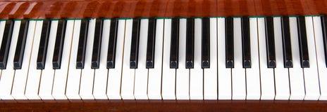 Στενός επάνω πιάνων, χειροκροτήματα πιάνων Υπόβαθρο Στοκ Φωτογραφία