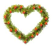 Στεφάνι Χριστουγέννων με μορφή της καρδιάς που απομονώνεται στο λευκό Στοκ φωτογραφία με δικαίωμα ελεύθερης χρήσης