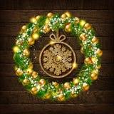 Στεφάνι Χριστουγέννων με χρυσό snowflake Απεικόνιση αποθεμάτων