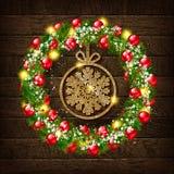 Στεφάνι Χριστουγέννων με χρυσό snowflake Ελεύθερη απεικόνιση δικαιώματος