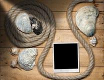 Στιγμιαία φωτογραφία - σχοινί και θαλασσινά κοχύλια Στοκ Εικόνα