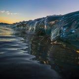Στιλπνό σαφές κύμα ηλιοβασιλέματος Στοκ Φωτογραφίες