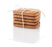 Στοίβα των μπισκότων που δένονται με το νήμα Στοκ εικόνα με δικαίωμα ελεύθερης χρήσης