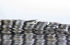 Στοίβα των νομισμάτων στην άσπρη ανασκόπηση Στοκ Εικόνα