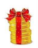 Στοίβα των χρυσών νομισμάτων με την κορδέλλα και το τόξο Στοκ Εικόνα