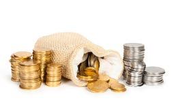 στοίβα χρημάτων νομισμάτων τσαντών Στοκ Εικόνες