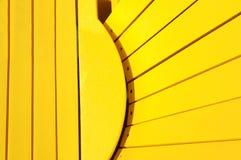 Κίτρινη καρέκλα adirondack Στοκ Φωτογραφία