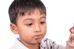 Στοματικό μικρό παιδί βρώμικο Στοκ Φωτογραφίες