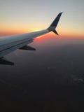 Στον αέρα και στο ηλιοβασίλεμα Στοκ φωτογραφία με δικαίωμα ελεύθερης χρήσης