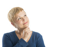 Στοχαστική γυναίκα με το χέρι στο πηγούνι που ανατρέχει Στοκ φωτογραφίες με δικαίωμα ελεύθερης χρήσης