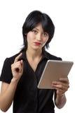 Στοχαστική επιχειρησιακή γυναίκα που χρησιμοποιεί την τεχνολογία Στοκ Εικόνες