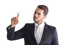 Στοχαστικός επιχειρηματίας που δείχνει κάτι με το δάχτυλό του Στοκ Εικόνες
