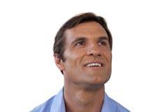 Στοχαστικός ώριμος επιχειρηματίας που χαμογελά ανατρέχοντας Στοκ φωτογραφία με δικαίωμα ελεύθερης χρήσης