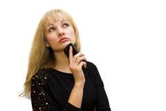 Στοχαστικό κορίτσι με το κινητό τηλέφωνο Στοκ φωτογραφία με δικαίωμα ελεύθερης χρήσης