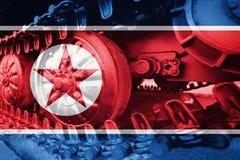 Στρατιωτική διαδρομή του Caterpillar κινηματογραφήσεων σε πρώτο πλάνο δεξαμενών με τη σημαία Β Βόρεια Κορεών Στοκ Φωτογραφίες