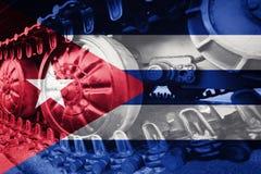 Στρατιωτική διαδρομή του Caterpillar κινηματογραφήσεων σε πρώτο πλάνο δεξαμενών με την κουβανική σημαία Backgro Στοκ φωτογραφία με δικαίωμα ελεύθερης χρήσης