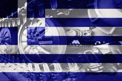 Στρατιωτική διαδρομή του Caterpillar κινηματογραφήσεων σε πρώτο πλάνο δεξαμενών με τη σημαία Backgr της Ελλάδας Στοκ εικόνες με δικαίωμα ελεύθερης χρήσης