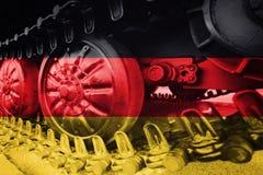 Στρατιωτική διαδρομή του Caterpillar κινηματογραφήσεων σε πρώτο πλάνο δεξαμενών με τη γερμανική σημαία Backgr Στοκ φωτογραφία με δικαίωμα ελεύθερης χρήσης