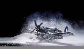 Στρατιωτικό αεροπλάνο Δεύτερου Παγκόσμιου Πολέμου με τις βαριές χιονοπτώσεις Στοκ εικόνες με δικαίωμα ελεύθερης χρήσης