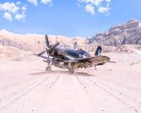 Στρατιωτικό αεροπλάνο Δεύτερου Παγκόσμιου Πολέμου που απογειώνεται στην έρημο Στοκ Εικόνα