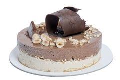 Στρογγυλό κέικ με τη σοκολάτα, το φουντούκι, τη βανίλια και το κακάο Στοκ φωτογραφία με δικαίωμα ελεύθερης χρήσης
