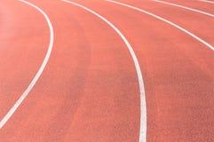 Στροφή της τρέχοντας διαδρομής σε ένα στάδιο Στοκ Φωτογραφία