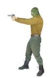 Στόχοι ατόμων με ένα πιστόλι Στοκ εικόνα με δικαίωμα ελεύθερης χρήσης