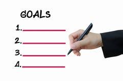 Στόχοι γραψίματος επιχειρησιακών χεριών Στοκ Φωτογραφίες